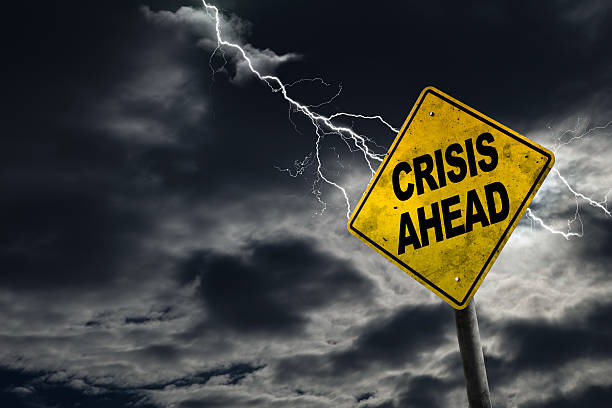crisis ahead sign with stormy background - crisi foto e immagini stock