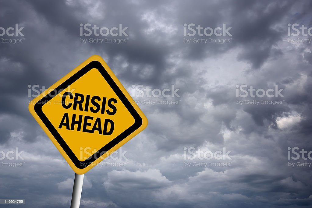 Crisis ahead warning sign stock photo