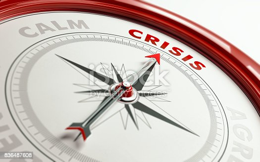 Arrow of a compass is pointing crisis text on the compass. Arrow, crisis text and the frame of compass are red in color. Horizontal composition qith copy space. Crisis concept.