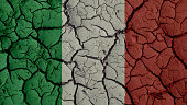 Crisis Concept: Mud Cracks With Italy Flag