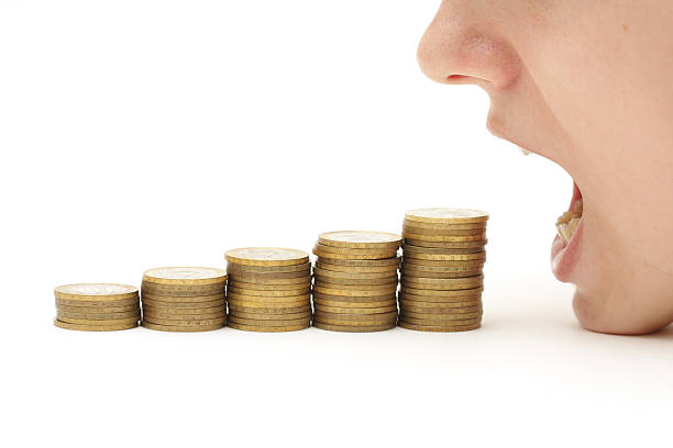 Crisis eating your money stock photo
