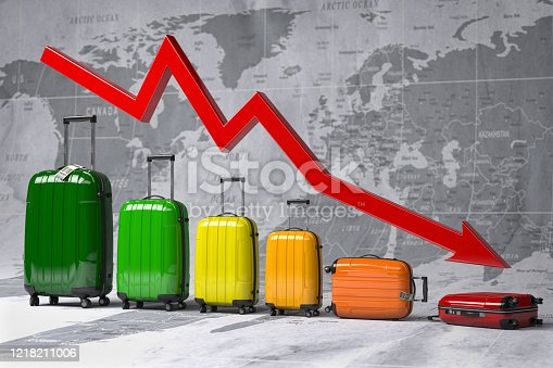 istock Crisis in travel and tourism industry. Graph and diagram from suitcases on the map of world. 1218211006