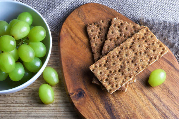 Crisp bread and grapes on the table closeup stock photo