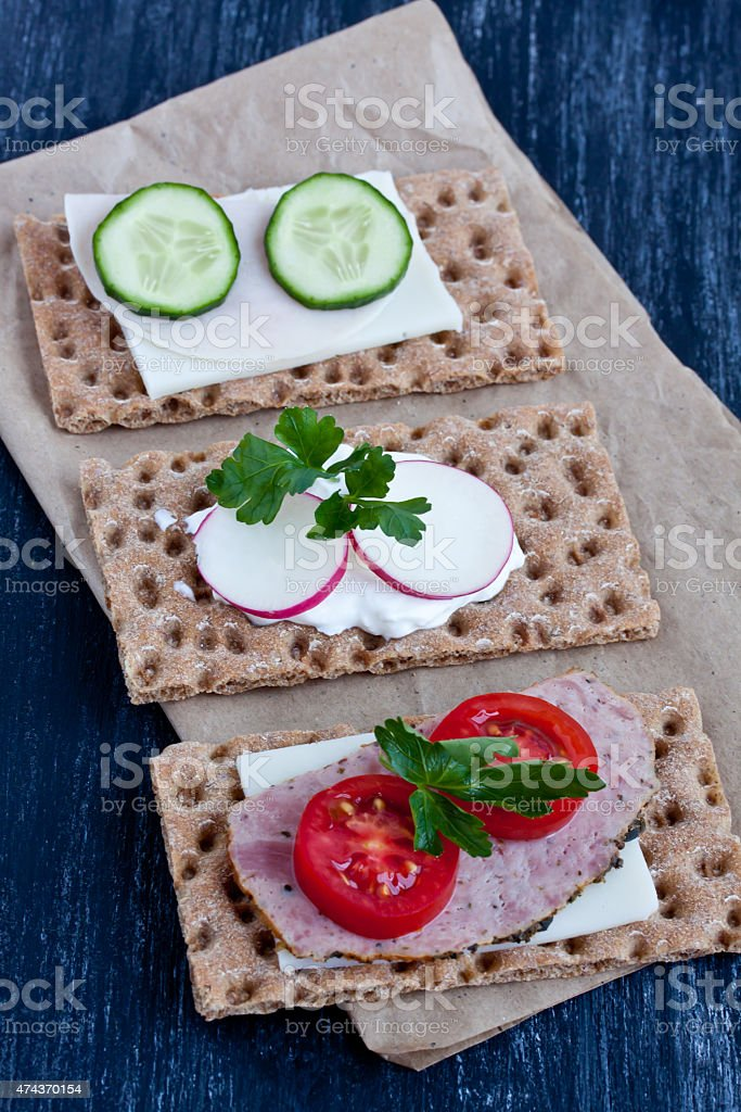 crisp bread with cheese and smoked turkey meat stock photo