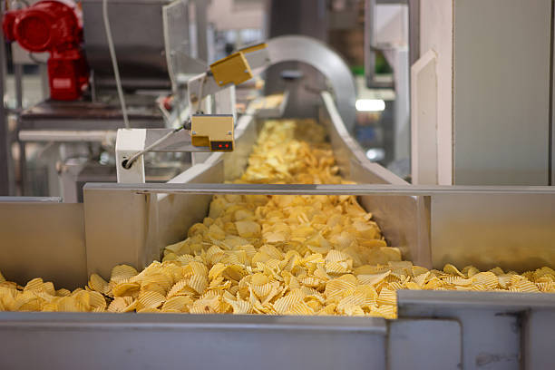 crisp factory - crisp packet stock photos and pictures