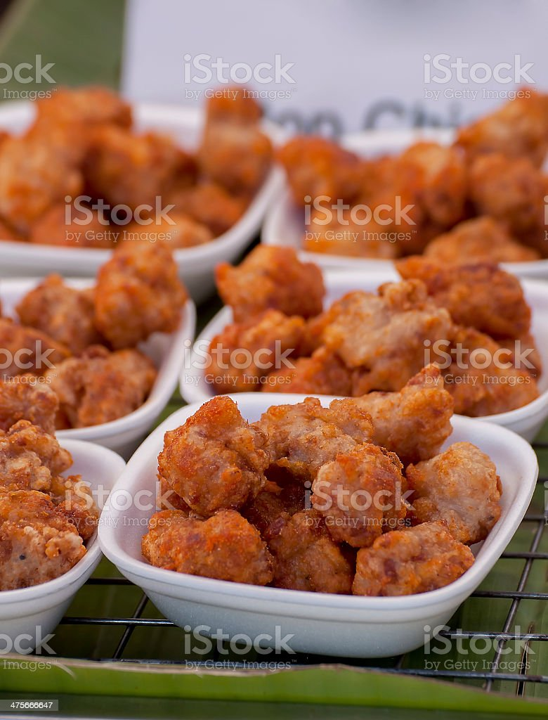 crisp fried crumbed chicken nuggets in foam cup stock photo