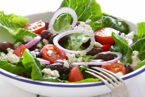 Crisp Greek salad in a white and blue bowl