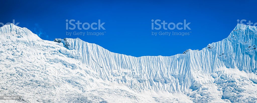 Crisp white snowy winter mountain background fluted glaciers peaks panorama stock photo