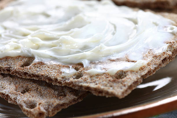 Crispbread with cheese spread stock photo