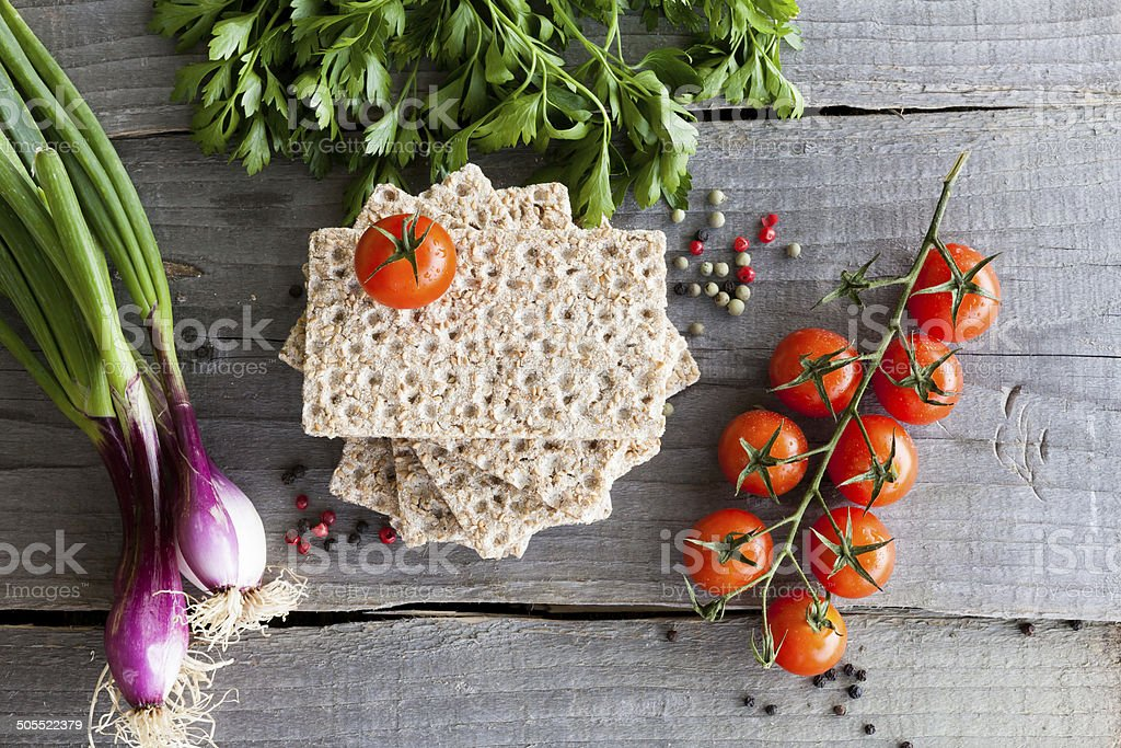 Crispbread with tomatoes, parsley, onion and pepper stock photo