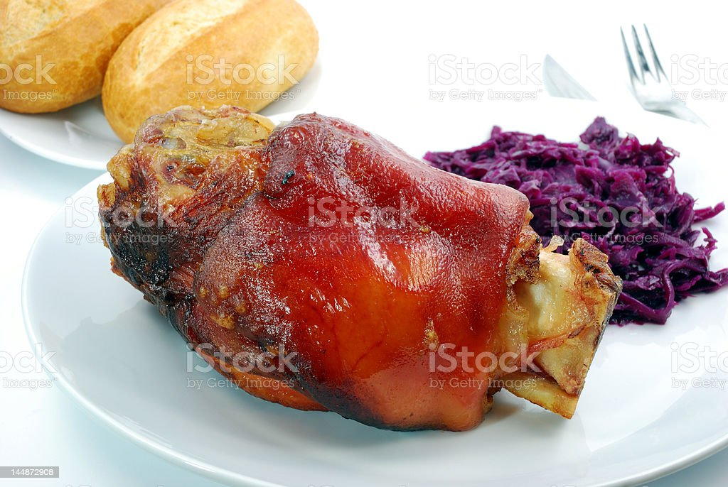 crisply knuckle with red cabbage stock photo
