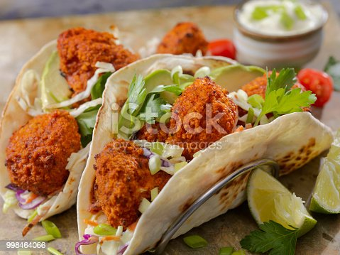 Crispy Baked Buffalo Wing Cauliflower Tacos with Creamy Coleslaw, Avocado, Cilantro and Ranch Sauce