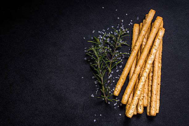 Crispy breadsticks with salt and fresh rosemary stock photo