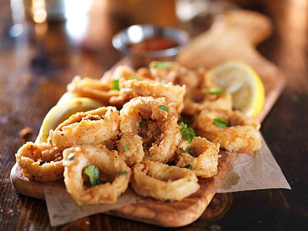 crispy calamari rings stock photo