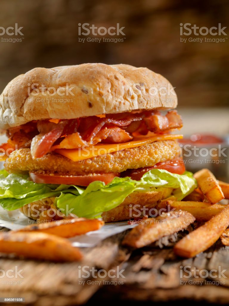 Crispy Chicken BLT Burger with Fries stock photo