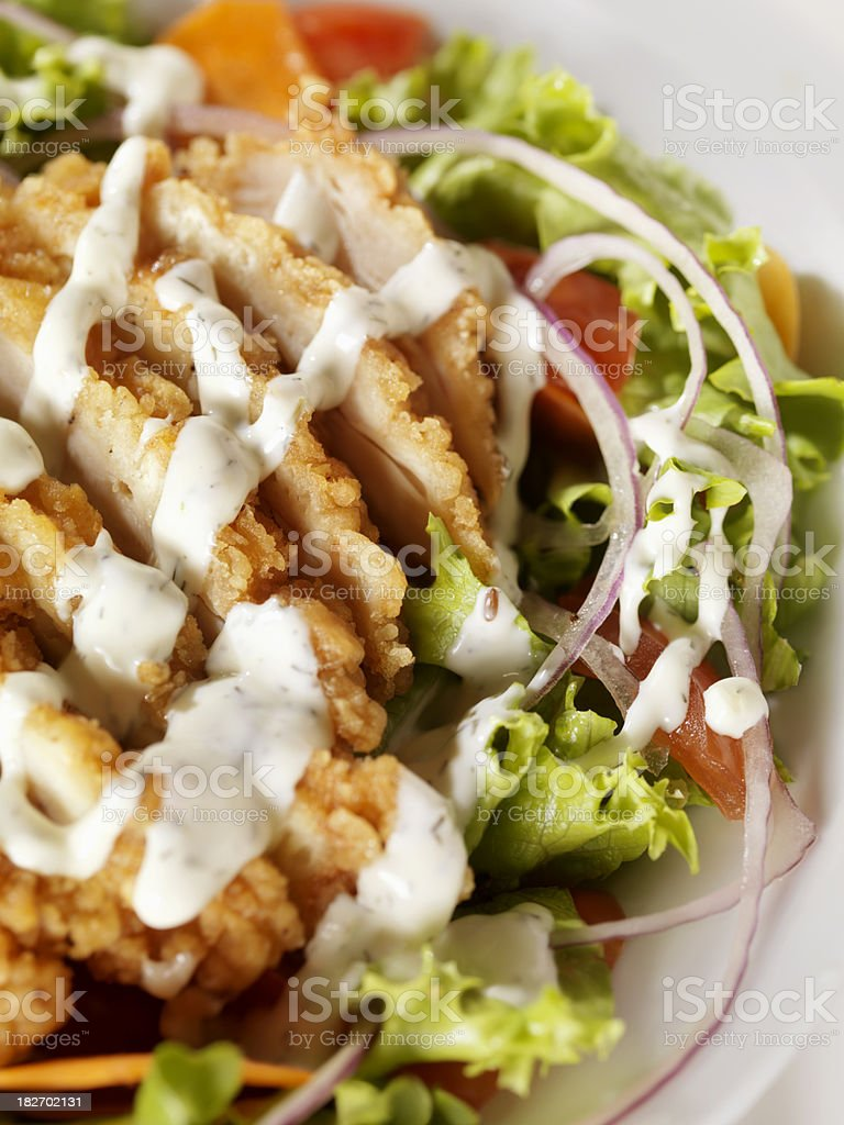 Crispy Chicken Breast Salad with Ranch Dressing stock photo