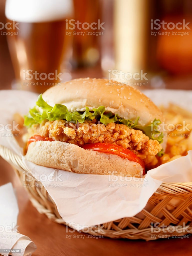 Crispy Chicken Burger with French Fries and a Beer royalty-free stock photo
