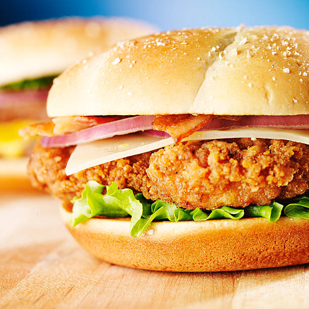 crispy chicken sandwich with bacon close up stock photo