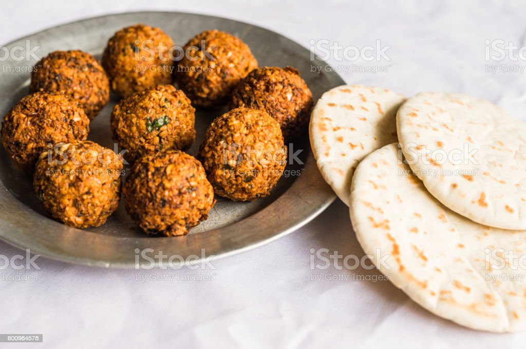 Crispy falafel and Arab pita bread against white background. Selective focus. stock photo