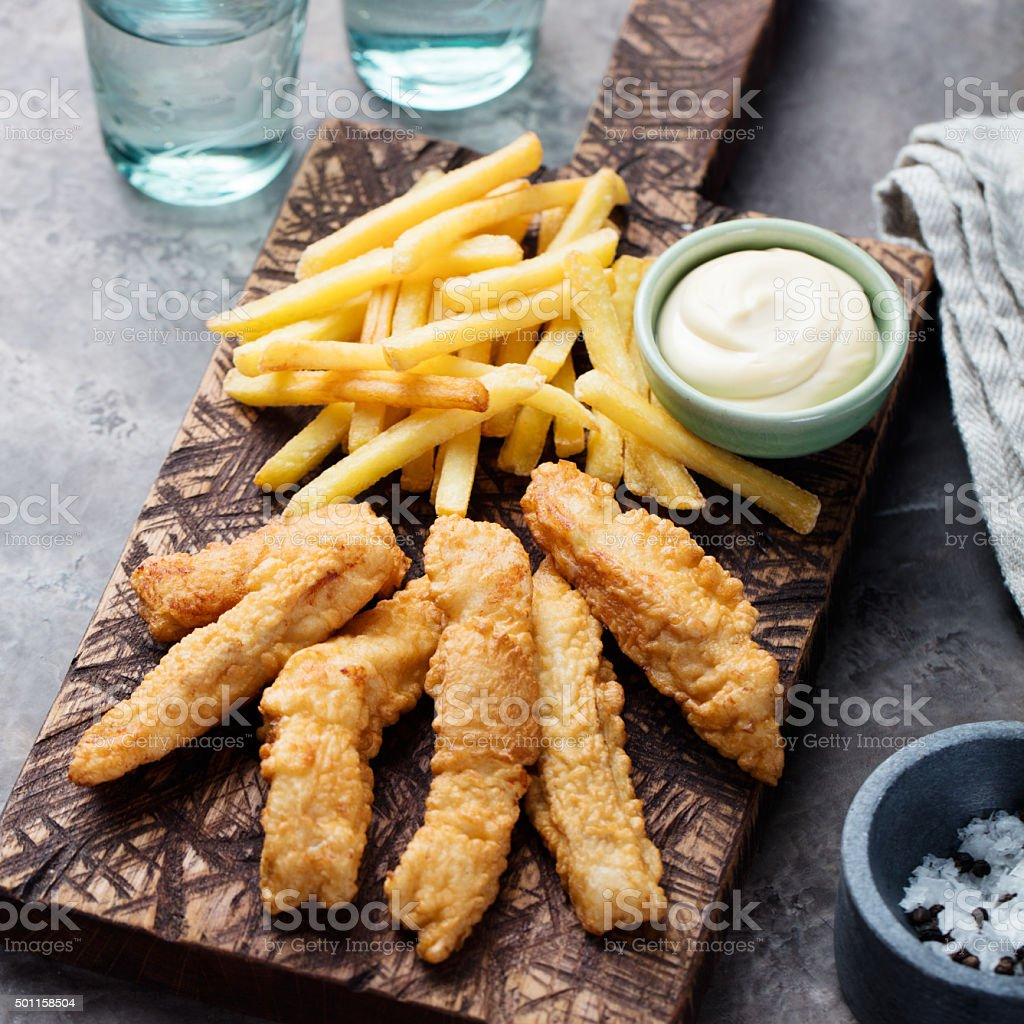 Crispy Fish and Chips, Tartar Sauce. British food stock photo