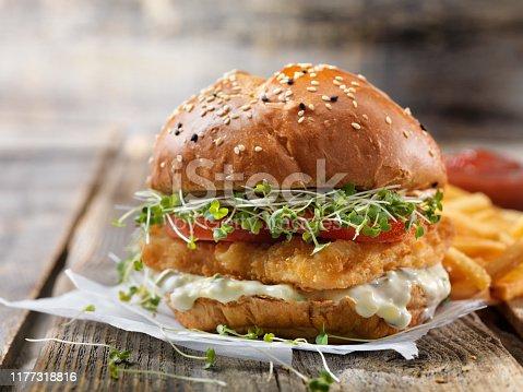 Crispy Fish Burger with Tarter Sauce, Lettuce, Tomato on a Brioche Bun