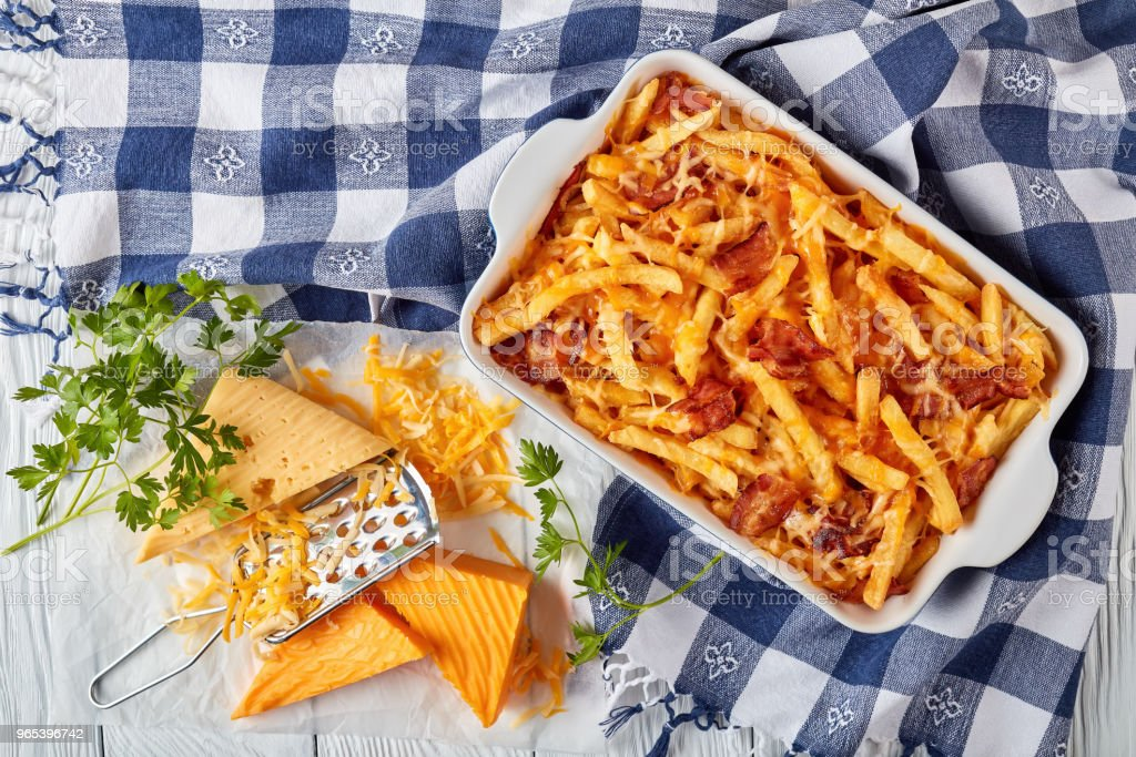 Crispy french fries smothered in melted cheese royalty-free stock photo