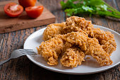 istock Crispy fried breaded chicken strips on plate 1213222041