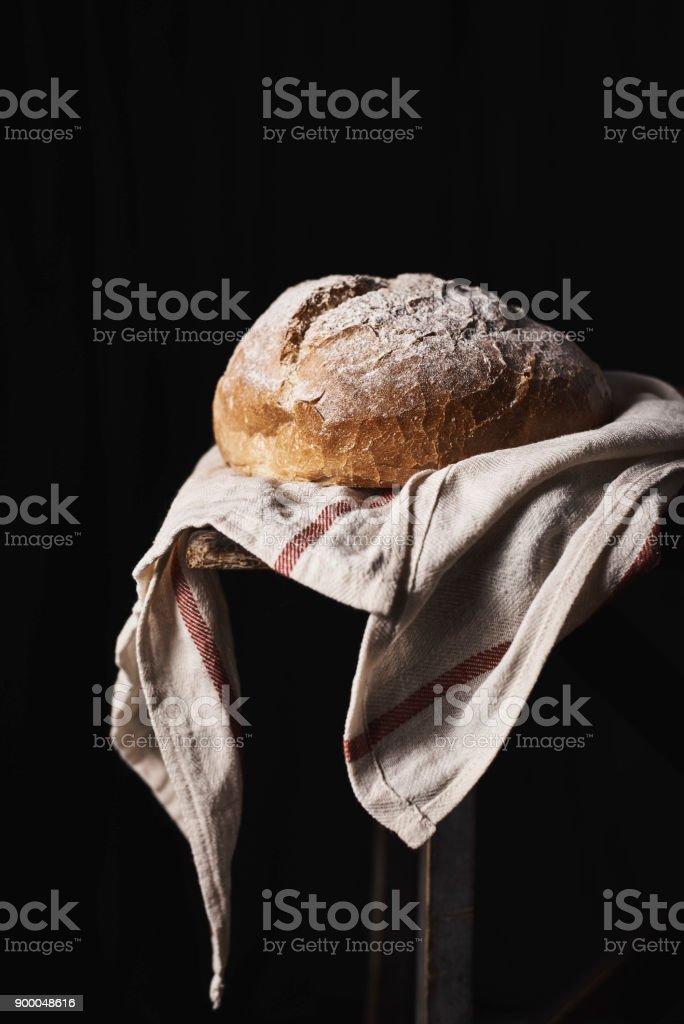 Crispy golden bread on towel stock photo