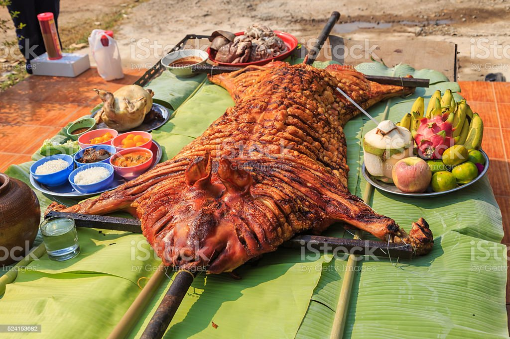 crispy grilled suckling pig on banana leaves stock photo