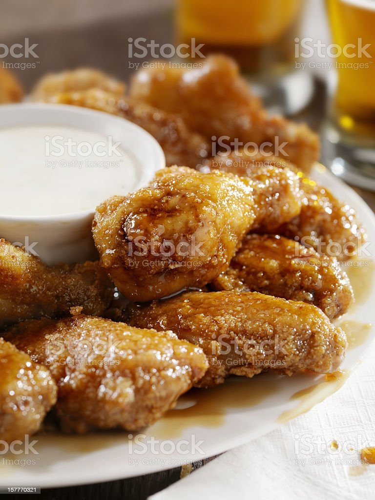 Crispy Honey Garlic Chicken Wings and Beer royalty-free stock photo