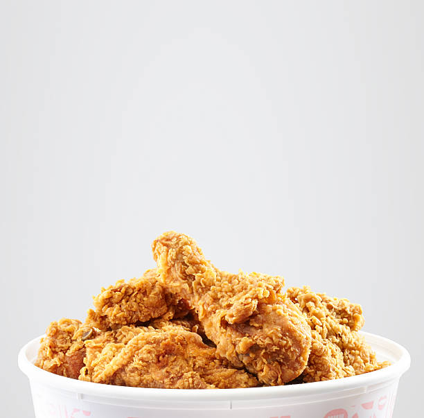 crispy kentucky fried chicken bucket - south stock photos and pictures