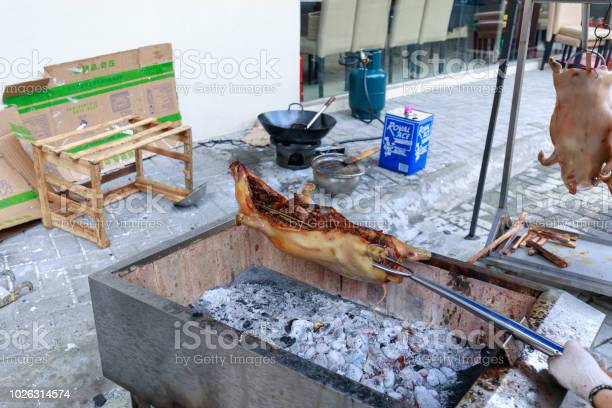 Crispy lechon being roasted in burning charcoal at manila restaurant picture id1026314574?b=1&k=6&m=1026314574&s=612x612&h=tqbyx9vwkidyltnbdwshln20yfya6smmo33fi1wnnbi=