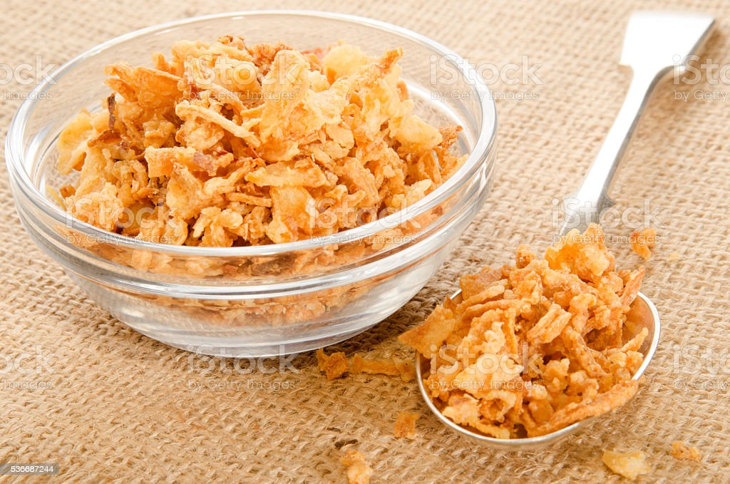 crispy onion in a glass bowl and spoon stock photo