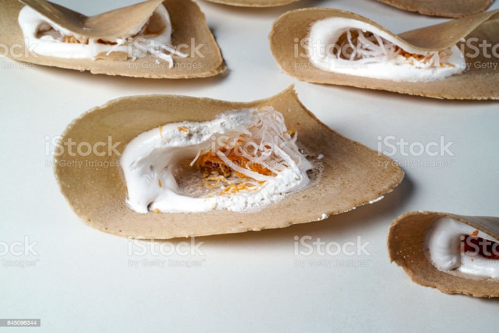 Crispy Pancakes crepes dessert Thai sweetmeat. (Khanom Buang) stock photo