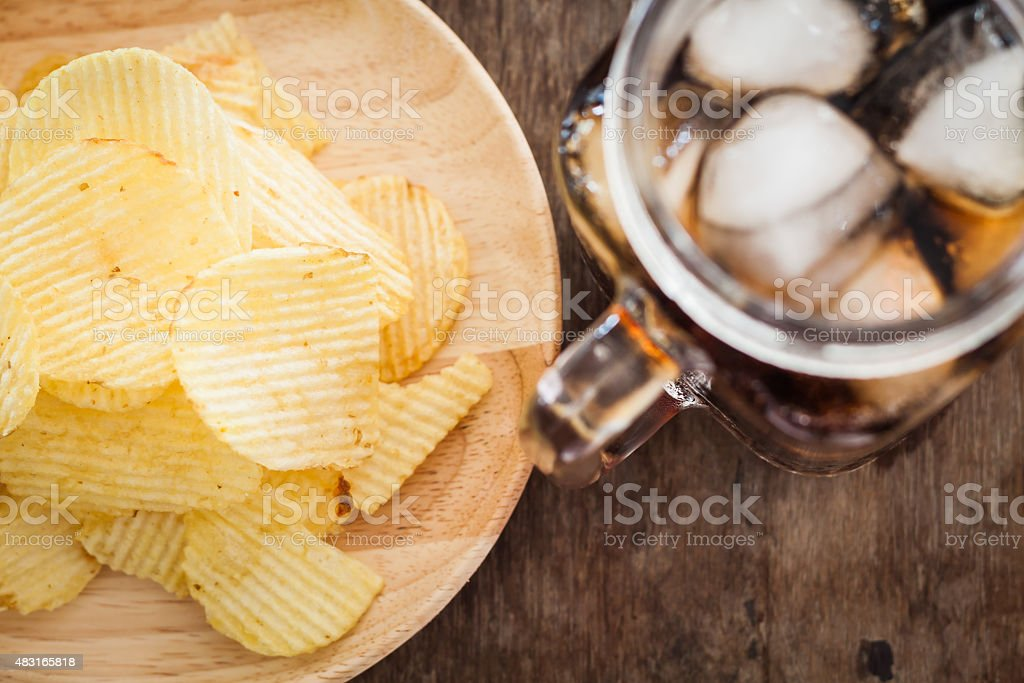 Crispy potato chips with iced cola stock photo