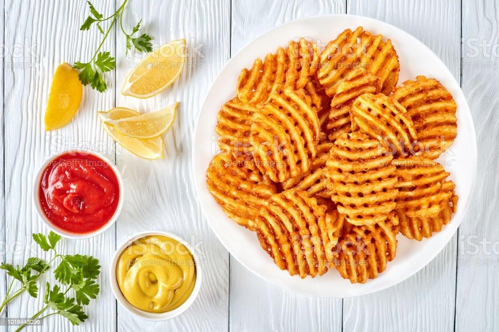Crispy Potato Waffles Fries Top View Stock Photo - Download