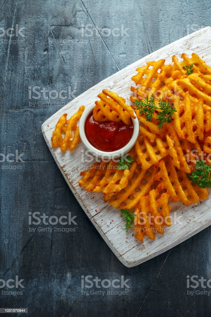 Crispy Potato Waffles Fries With Ketchup On White Wooden Board Stock Photo  - Download Image Now