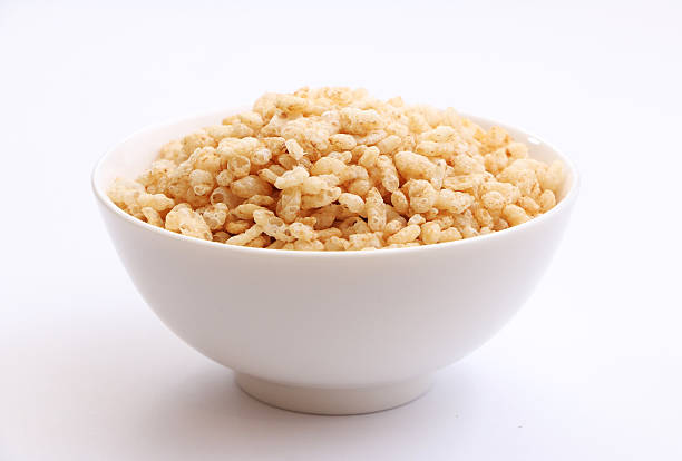 Crispy Rice Cereal 1 Start your morning with a giant bowl of crispy rice cereal. rice cereal plant stock pictures, royalty-free photos & images