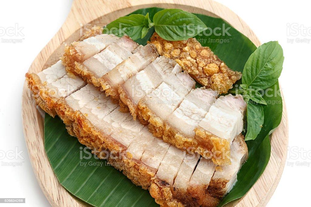 crispy roasted pork on white background stock photo