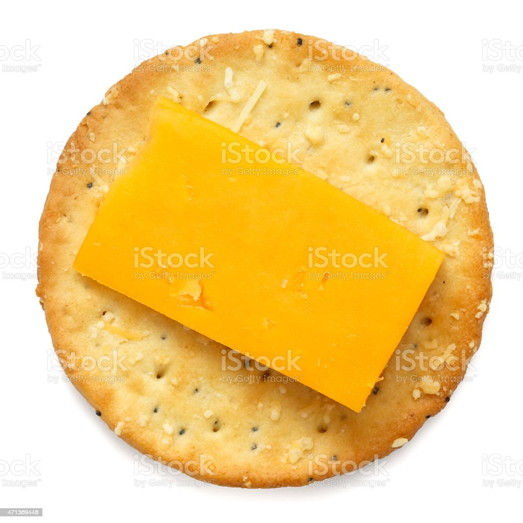 Crispy round cheese cracker from above. With cheddar. stock photo