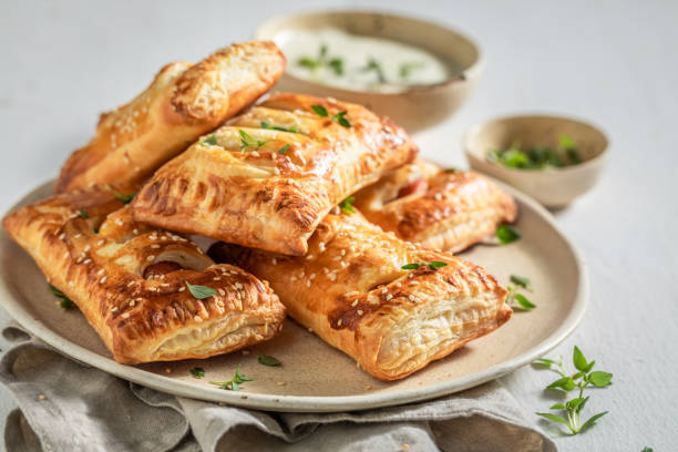 Crispy sausage roll with thyme and sesame seeds stock photo