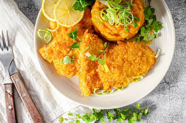 Crispy schnitzel with cornflakes stock photo