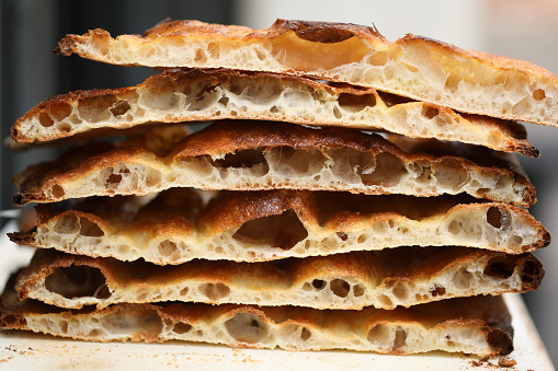 Crispy slices of focaccia pizza in Rome Italy