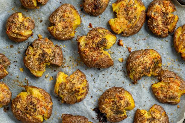 Crispy smashed potatoes roasted with garlic and parmesan. stock photo