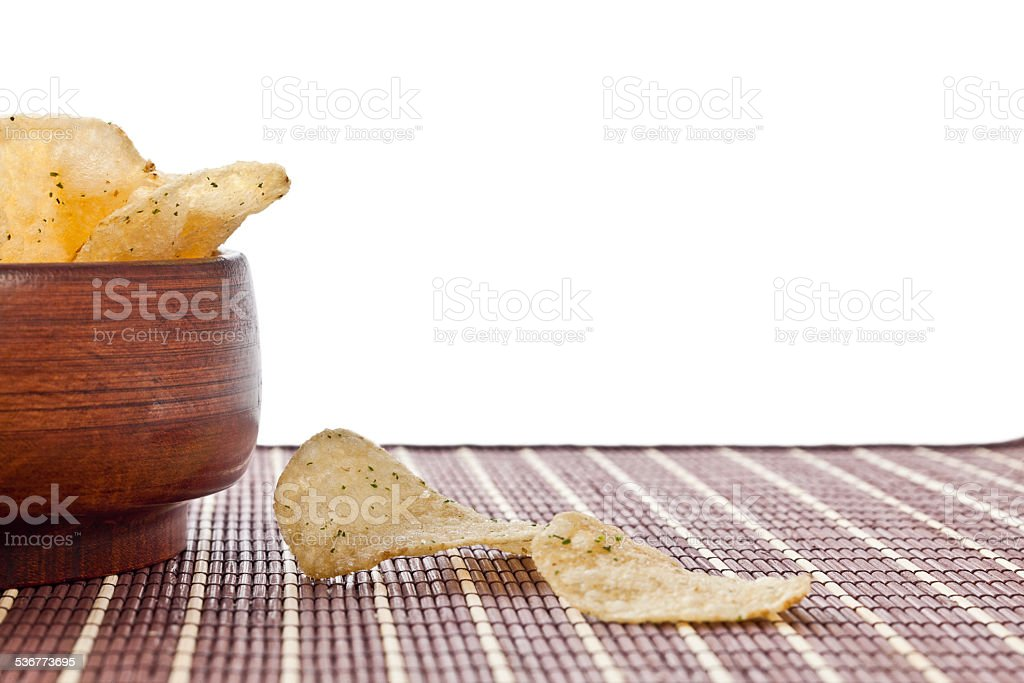 crispy sour cream and onion potato chips in wooden bowl stock photo