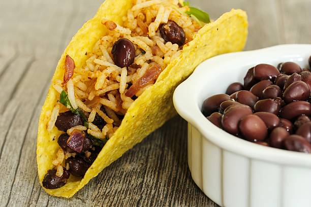Crispy taco with rice and beans stock photo