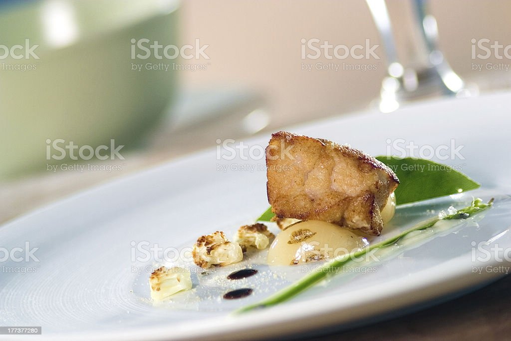 Crispy veal sweetbreads with cauliflower mousseline. royalty-free stock photo
