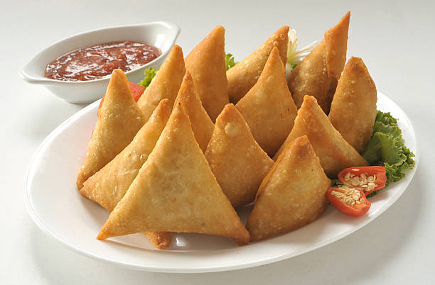 crispy vege samosa - samosa stock photos and pictures