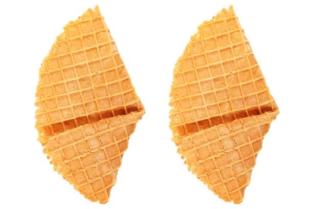 crispy waffle isolated on white - triangolo forma bidimensionale foto e immagini stock