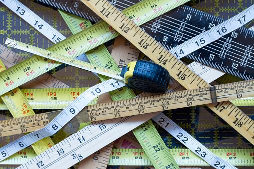 istock Crisscrossed tape measures 1127985901